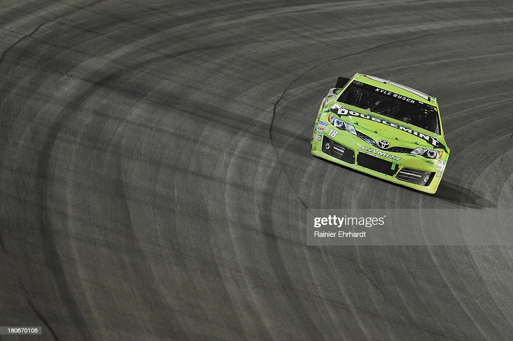 Kyle Busch, driver of the #18 Double Mint Gum Toyota, races during the NASCAR Sprint Cup Series Geico 400 at Chicagoland Speedway on September 15, 2013 in Joliet, Illinois.