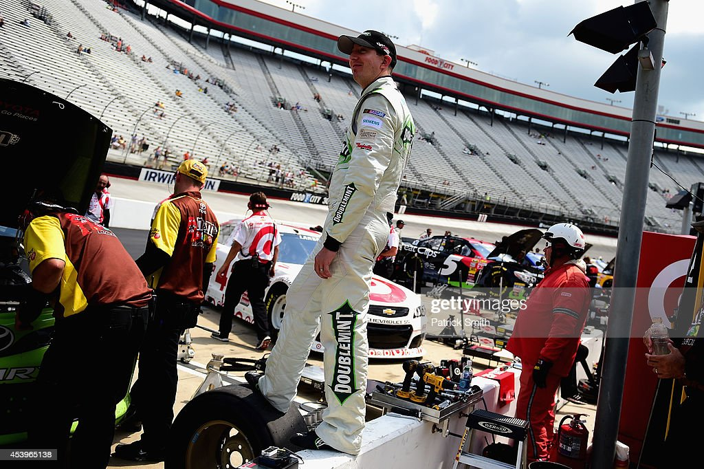 Kyle Busch, driver of the #18 Doublemint Toyota, stands on the pit wall during practice for the NASCAR Sprint Cup Series Irwin Tools Night Race at Bristol Motor Speedway on August 22, 2014 in Bristol, Tennessee.