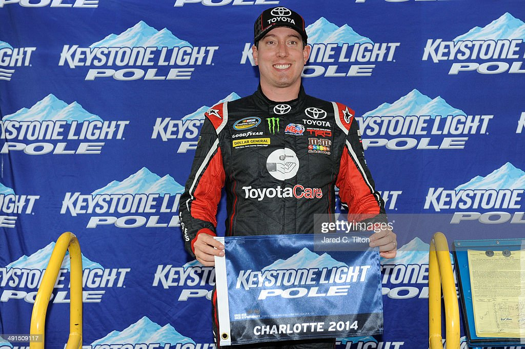 Kyle Busch driver of the Hiring Our Heroes/Toyota Care Toyota poses after qualifying for the pole position in the NASCAR Camping World Truck Series...