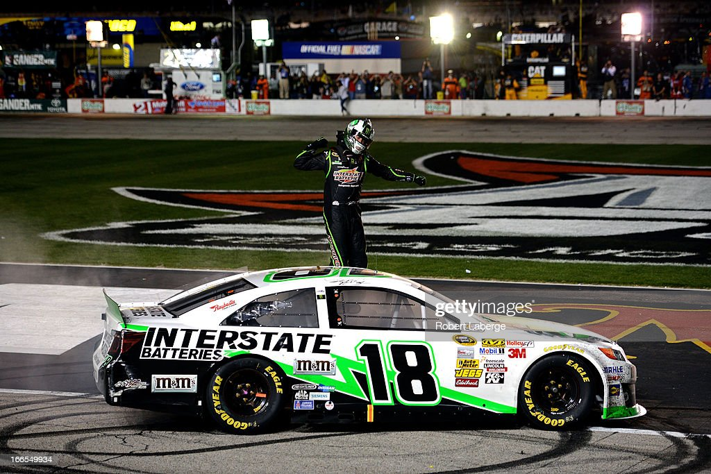 <a gi-track='captionPersonalityLinkClicked' href=/galleries/search?phrase=Kyle+Busch&family=editorial&specificpeople=211123 ng-click='$event.stopPropagation()'>Kyle Busch</a>, driver of the #18 Interstate Batteries Toyota, celebrates after winning the NASCAR Sprint Cup Series NRA 500 at Texas Motor Speedway on April 13, 2013 in Fort Worth, Texas.