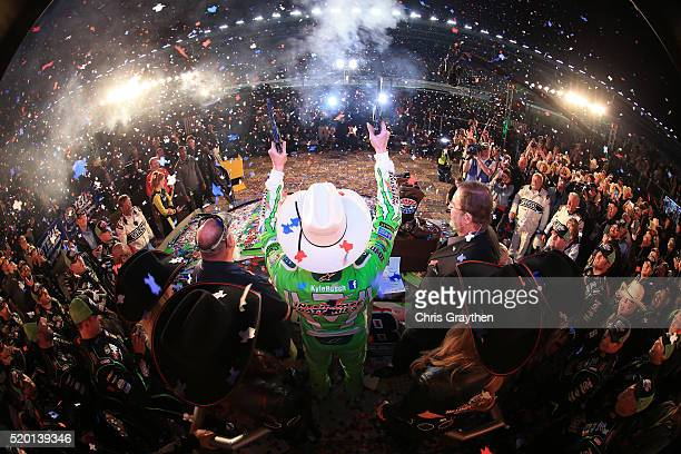Kyle Busch driver of the Interstate Batteries Toyota celebrates after winning the NASCAR Sprint Cup Series Duck Commander 500 at Texas Motor Speedway...