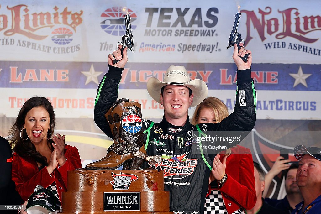 <a gi-track='captionPersonalityLinkClicked' href=/galleries/search?phrase=Kyle+Busch&family=editorial&specificpeople=211123 ng-click='$event.stopPropagation()'>Kyle Busch</a>, driver of the #18 Interstate Batteries Toyota, celebrates by shooting revolvers in Victory Lane after winning the NASCAR Sprint Cup Series NRA 500 at Texas Motor Speedway on April 13, 2013 in Fort Worth, Texas.