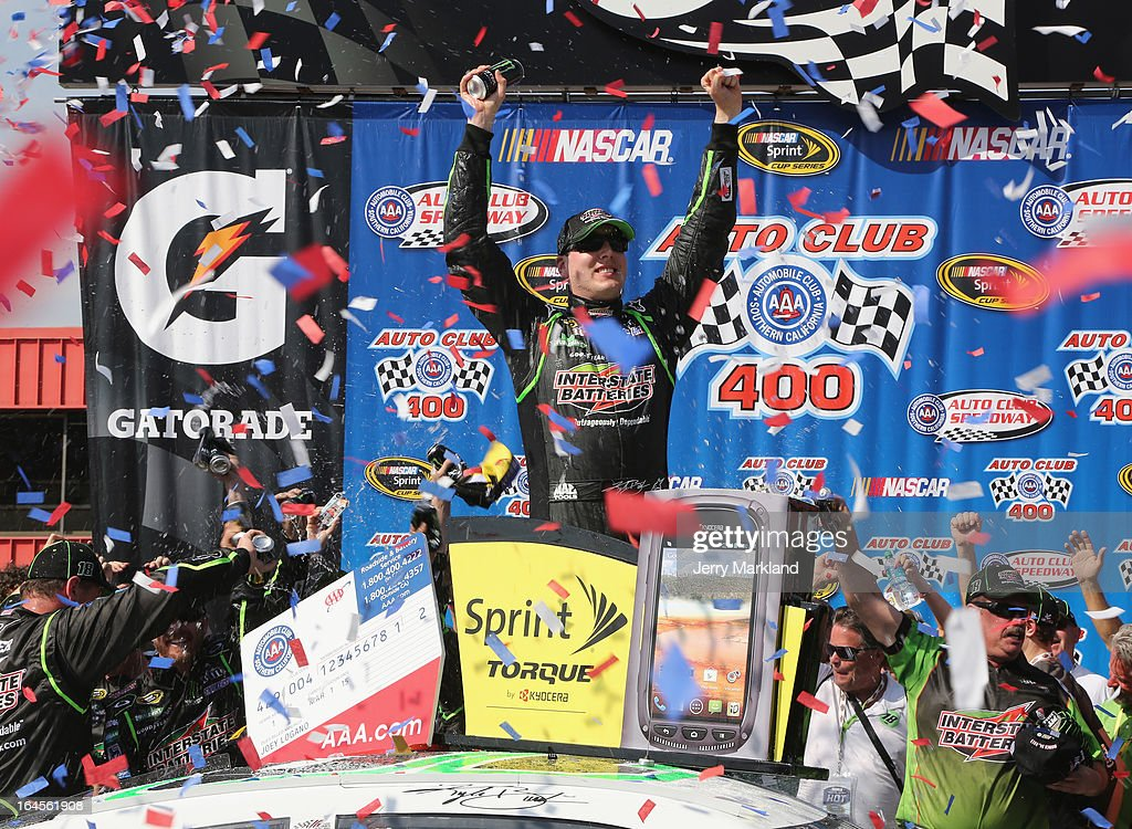 Kyle Busch, driver of the #18 Interstate Batteries Toyota, celebrates in Victory Lane after winning the NASCAR Sprint Cup Series Auto Club 400 at Auto Club Speedway on March 24, 2013 in Fontana, California.