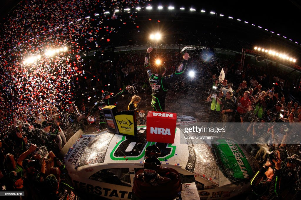 <a gi-track='captionPersonalityLinkClicked' href=/galleries/search?phrase=Kyle+Busch&family=editorial&specificpeople=211123 ng-click='$event.stopPropagation()'>Kyle Busch</a>, driver of the #18 Interstate Batteries Toyota, celebrates in victory lane after winning the NASCAR Sprint Cup Series NRA 500 at Texas Motor Speedway on April 13, 2013 in Fort Worth, Texas.