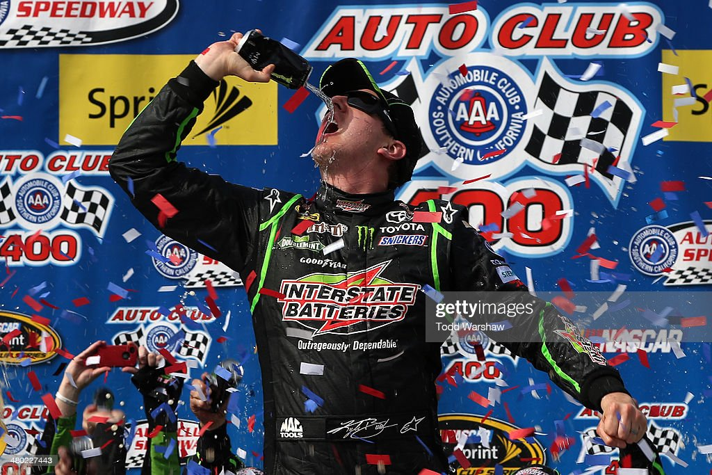 <a gi-track='captionPersonalityLinkClicked' href=/galleries/search?phrase=Kyle+Busch&family=editorial&specificpeople=211123 ng-click='$event.stopPropagation()'>Kyle Busch</a>, driver of the #18 Interstate Batteries Toyota, celebrates in Victory Lane after winning the NASCAR Sprint Cup Series Auto Club 400 at Auto Club Speedway on March 23, 2014 in Fontana, California.