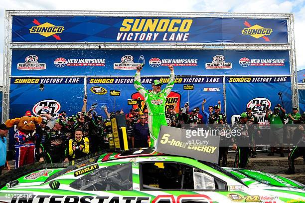 Kyle Busch driver of the Interstate Batteries Toyota celebrates in Victory Lane after winning the NASCAR Sprint Cup Series 5Hour ENERGY 301 at New...