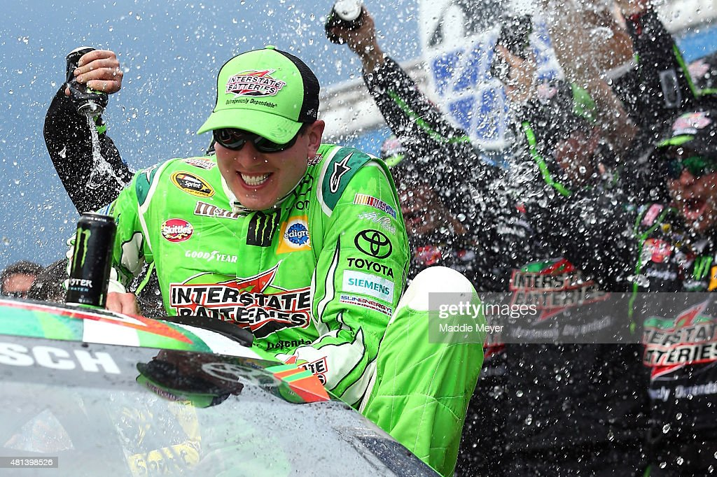 <a gi-track='captionPersonalityLinkClicked' href=/galleries/search?phrase=Kyle+Busch&family=editorial&specificpeople=211123 ng-click='$event.stopPropagation()'>Kyle Busch</a>, driver of the #18 Interstate Batteries Toyota, celebrates in Victory Lane after winning the NASCAR Sprint Cup Series 5-Hour ENERGY 301 at New Hampshire Motor Speedway on July 19, 2015 in Loudon, New Hampshire.