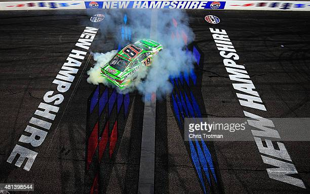Kyle Busch driver of the Interstate Batteries Toyota celebrates with a burnout after winning the NASCAR Sprint Cup Series 5Hour ENERGY 301 at New...