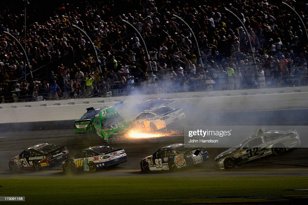 Kyle Busch, driver of the #18 Interstate Batteries Toyota, Danica Patrick, driver of the #10 GoDaddy.com Chevrolet, David Gilliland, driver of the #38 Long John Silver's Ford, and JJ Yeley, driver of the #36 Golden Corral Chevrolet, crash during the NASCAR Sprint Cup Series Coke Zero 400 at Daytona International Speedway on July 6, 2013 in Daytona Beach, Florida.