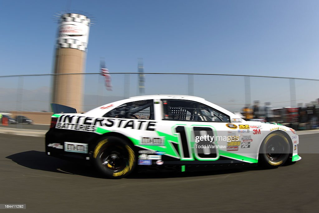 Kyle Busch, driver of the #18 Interstate Batteries Toyota, drives to the garage area during practice for the NASCAR Sprint Cup Series Auto Club 400 at Auto Club Speedway on March 23, 2013 in Fontana, California.