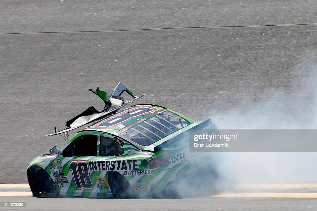 <a gi-track='captionPersonalityLinkClicked' href=/galleries/search?phrase=Kyle+Busch&family=editorial&specificpeople=211123 ng-click='$event.stopPropagation()'>Kyle Busch</a>, driver of the #18 Interstate Batteries Toyota, has an on track incident during practice for the NASCAR Sprint Cup Series Coke Zero 400 at Daytona International Speedway on July 1, 2016 in Daytona Beach, Florida.