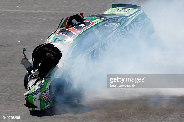 Kyle Busch driver of the Interstate Batteries Toyota has an on track incident during practice for the NASCAR Sprint Cup Series Coke Zero 400 at...