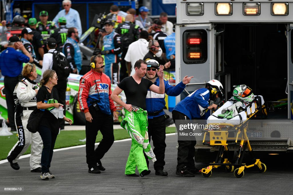 Kyle Busch, driver of the #18 Interstate Batteries Toyota, is taken by amulance to the infield care center after finishing the Monster Energy NASCAR Cup Series Bank of America 500 at Charlotte Motor Speedway on October 8, 2017 in Charlotte, North Carolina.