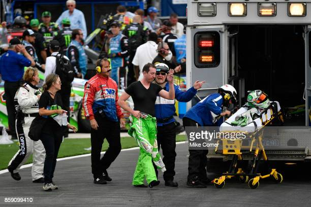Kyle Busch driver of the Interstate Batteries Toyota is taken by amulance to the infield care center after finishing the Monster Energy NASCAR Cup...