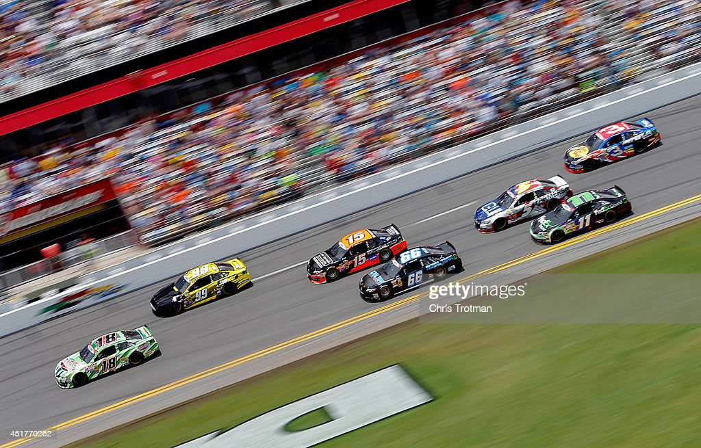 Kyle Busch, driver of the #18 Interstate Batteries Toyota, leads a pack of cars during the NASCAR Sprint Cup Series Coke Zero 400 at Daytona International Speedway on July 6, 2014 in Daytona Beach, Florida.