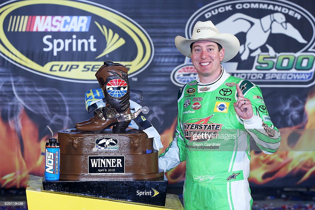 <a gi-track='captionPersonalityLinkClicked' href=/galleries/search?phrase=Kyle+Busch&family=editorial&specificpeople=211123 ng-click='$event.stopPropagation()'>Kyle Busch</a>, driver of the #18 Interstate Batteries Toyota, poses in Victory Lane after winning the NASCAR Sprint Cup Series Duck Commander 500 at Texas Motor Speedway on April 9, 2016 in Fort Worth, Texas.