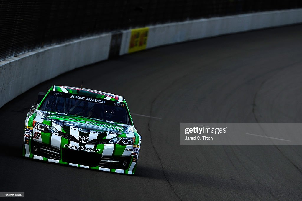Kyle Busch, driver of the #18 Interstate Batteries Toyota, qualifies for the NASCAR Sprint Cup Series Pure Michigan 400 at Michigan International Speedway on August 15, 2014 in Brooklyn, Michigan.