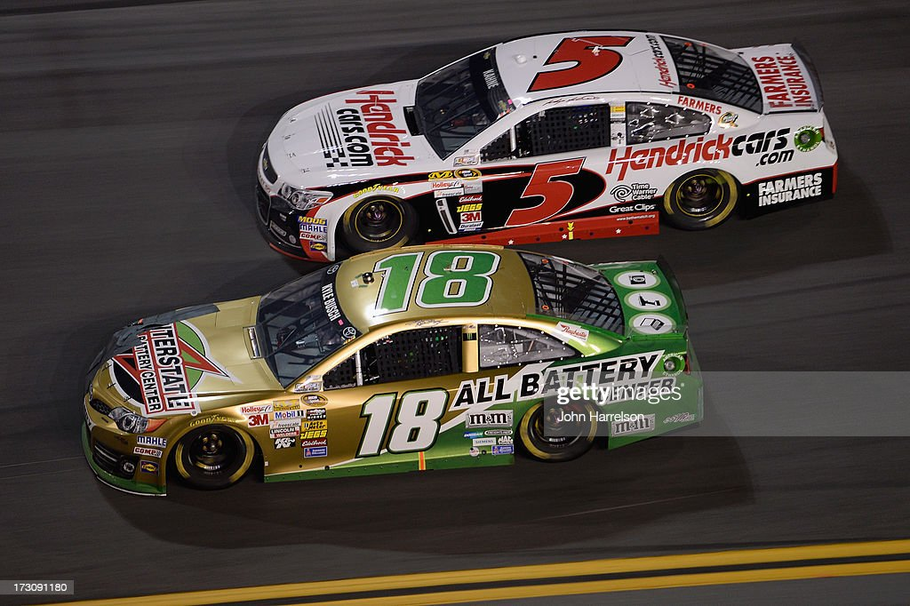 Kyle Busch, driver of the #18 Interstate Batteries Toyota, races Kasey Kahne, driver of the #5 Hendrickcars.com Chevrolet, during the NASCAR Sprint Cup Series Coke Zero 400 at Daytona International Speedway on July 6, 2013 in Daytona Beach, Florida.