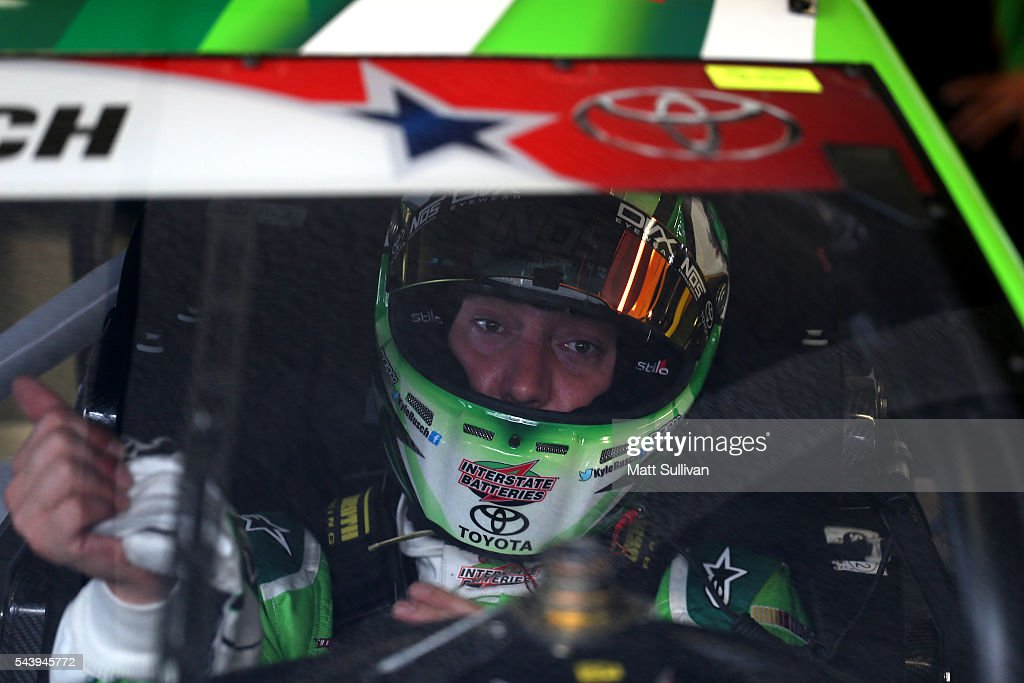 <a gi-track='captionPersonalityLinkClicked' href=/galleries/search?phrase=Kyle+Busch&family=editorial&specificpeople=211123 ng-click='$event.stopPropagation()'>Kyle Busch</a>, driver of the #18 Interstate Batteries Toyota, sits in his car during practice for the NASCAR Sprint Cup Series Coke Zero 400 at Daytona International Speedway on June 30, 2016 in Daytona Beach, Florida.