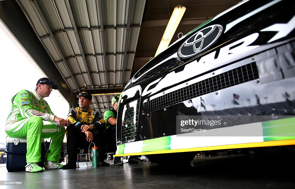 <a gi-track='captionPersonalityLinkClicked' href=/galleries/search?phrase=Kyle+Busch&family=editorial&specificpeople=211123 ng-click='$event.stopPropagation()'>Kyle Busch</a>, driver of the #18 Interstate Batteries Toyota, talks to <a gi-track='captionPersonalityLinkClicked' href=/galleries/search?phrase=Matt+Kenseth&family=editorial&specificpeople=204192 ng-click='$event.stopPropagation()'>Matt Kenseth</a>, driver of the #20 DeWalt Toyota, in the garage area during practice for the NASCAR Sprint Cup Series Coke Zero 400 at Daytona International Speedway on June 30, 2016 in Daytona Beach, Florida.