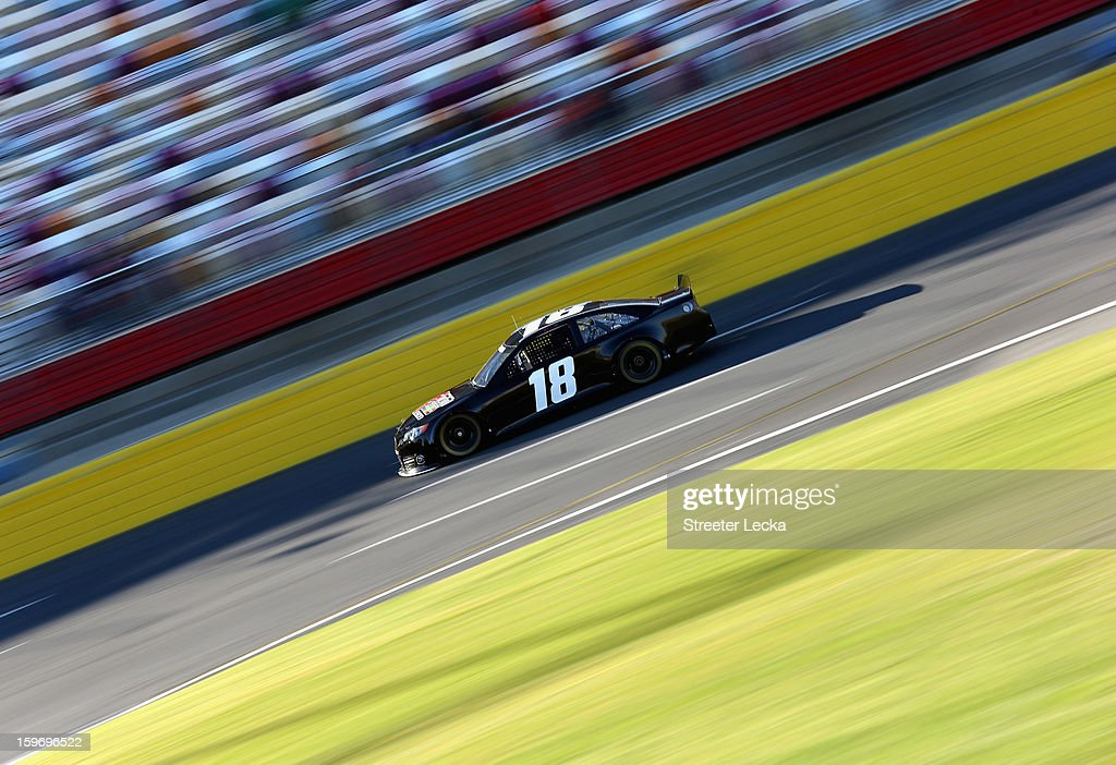 <a gi-track='captionPersonalityLinkClicked' href=/galleries/search?phrase=Kyle+Busch&family=editorial&specificpeople=211123 ng-click='$event.stopPropagation()'>Kyle Busch</a>, driver of the #18 Joe Gibbs Racing Toyota, in action during NASCAR Testing at Charlotte Motor Speedway on January 18, 2013 in Charlotte, North Carolina.
