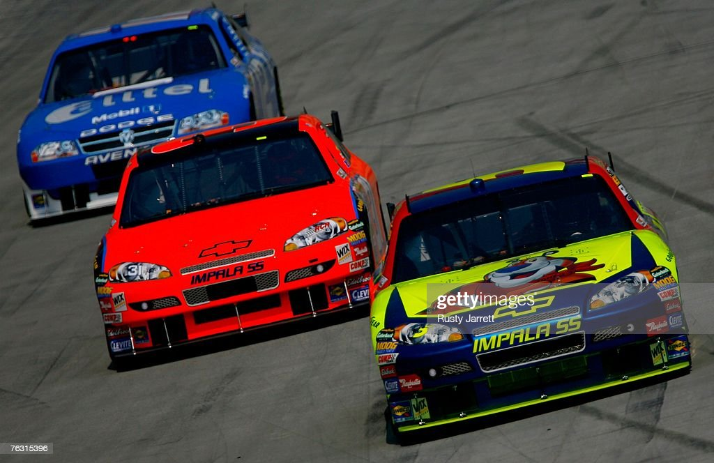 Kyle Busch driver of the Kellogg's/CARQUEST Chevrolet drives ahead of Jeff Burton driver of the RCR Chevrolet and Ryan Newman driver of the alltel...