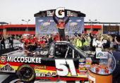 Kyle Busch driver of the Micossukee Resort/Tundra Toyota celebrates in victory lane after winning the NASCAR Camping World Truck Series San...