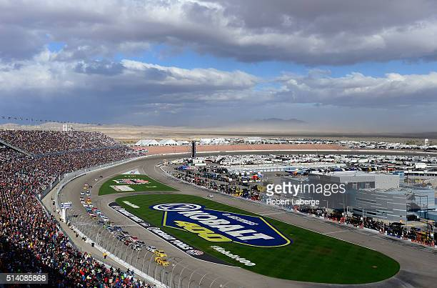 Kyle Busch driver of the MM's 75 Toyota leads a pack of cars during the NASCAR Sprint Cup Series Kobalt 400 at Las Vegas Motor Speedway on March 6...