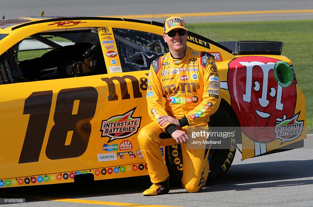 <a gi-track='captionPersonalityLinkClicked' href=/galleries/search?phrase=Kyle+Busch&family=editorial&specificpeople=211123 ng-click='$event.stopPropagation()'>Kyle Busch</a>, driver of the #18 M&M's 75 Toyota, poses with his car after qualifying for the NASCAR Sprint Cup Series Daytona 500 at Daytona International Speedway on February 14, 2016 in Daytona Beach, Florida.