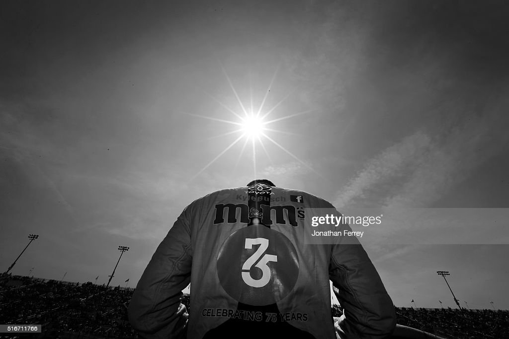 Kyle Busch driver of the MM's 75 Toyota stands on the grid before the NASCAR Sprint Cup Series Auto Club 400 at Auto Club Speedway on March 20 2016...