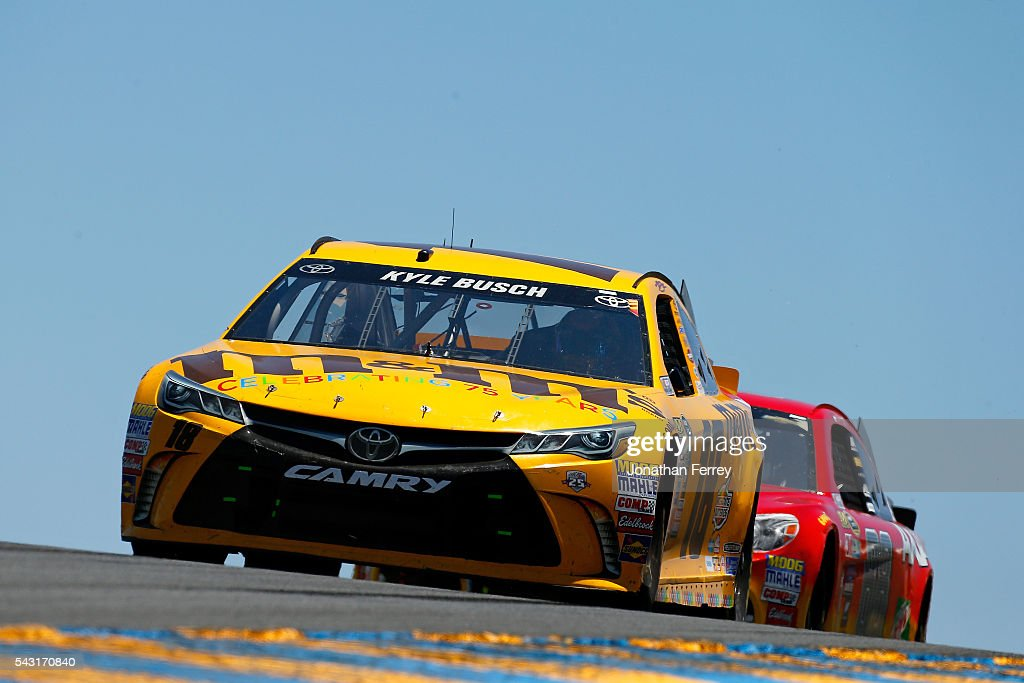 <a gi-track='captionPersonalityLinkClicked' href=/galleries/search?phrase=Kyle+Busch&family=editorial&specificpeople=211123 ng-click='$event.stopPropagation()'>Kyle Busch</a>, driver of the #18 M&M's 75th Anniversary Toyota, leads Dale Earnhardt Jr, driver of the #88 Axalta Chevrolet, during the NASCAR Sprint Cup Series Toyota/Save Mart 350 at Sonoma Raceway on June 26, 2016 in Sonoma, California.
