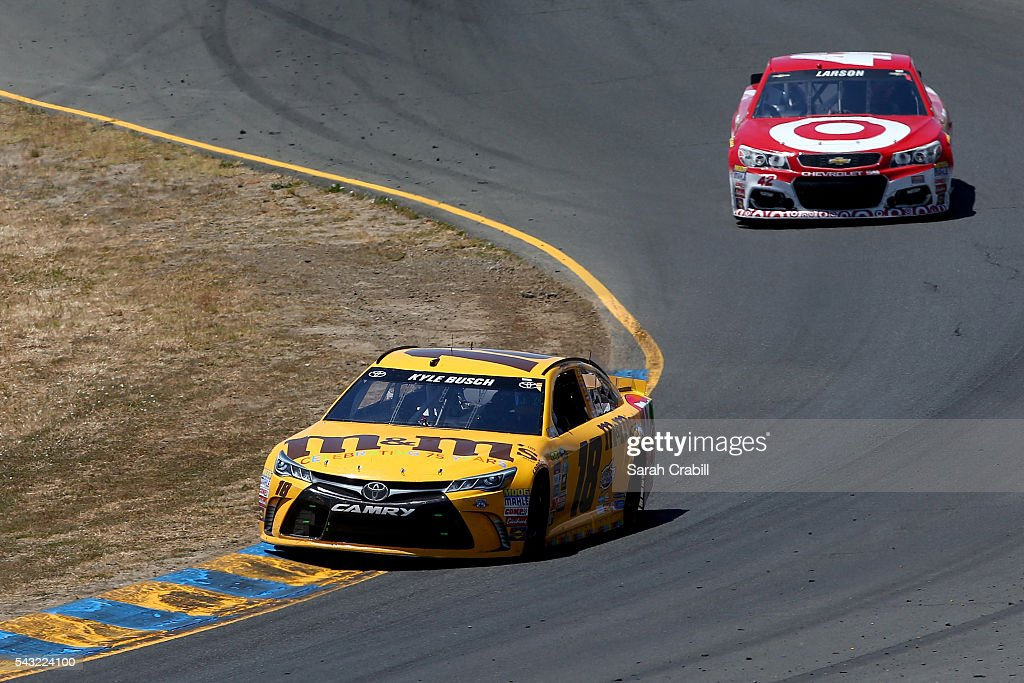 <a gi-track='captionPersonalityLinkClicked' href=/galleries/search?phrase=Kyle+Busch&family=editorial&specificpeople=211123 ng-click='$event.stopPropagation()'>Kyle Busch</a>, driver of the #18 M&M's 75th Anniversary Toyota, races <a gi-track='captionPersonalityLinkClicked' href=/galleries/search?phrase=Kyle+Larson+-+Race+Car+Driver&family=editorial&specificpeople=2115989 ng-click='$event.stopPropagation()'>Kyle Larson</a>, driver of the #42 Target Chevrolet, during the NASCAR Sprint Cup Series Toyota/Save Mart 350 at Sonoma Raceway on June 26, 2016 in Sonoma, California.