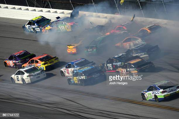 Kyle Busch driver of the MM's Caramel Toyota and Jimmie Johnson driver of the Lowe's Chevrolet are involved in an ontrack incident during the Monster...