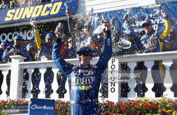 Kyle Busch driver of the MM's Caramel Toyota celebrates in Victory Lane after winning the Monster Energy NASCAR Cup Series Overton's 400 at Pocono...