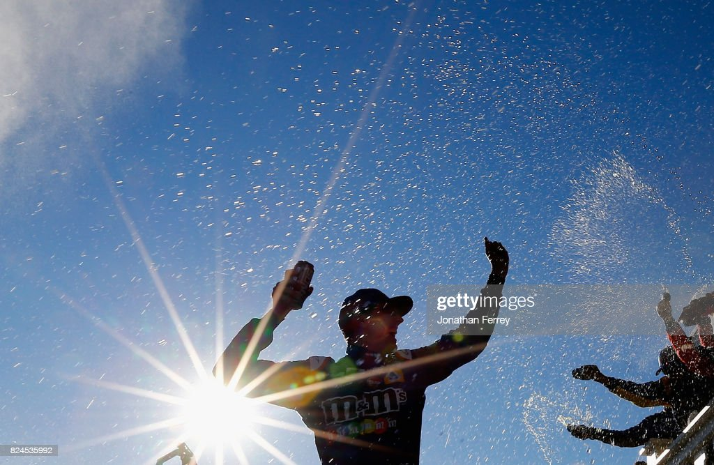Kyle Busch, driver of the #18 M&M's Caramel Toyota, celebrates in Victory Lane after winning the Monster Energy NASCAR Cup Series Overton's 400 at Pocono Raceway on July 30, 2017 in Long Pond, Pennsylvania.