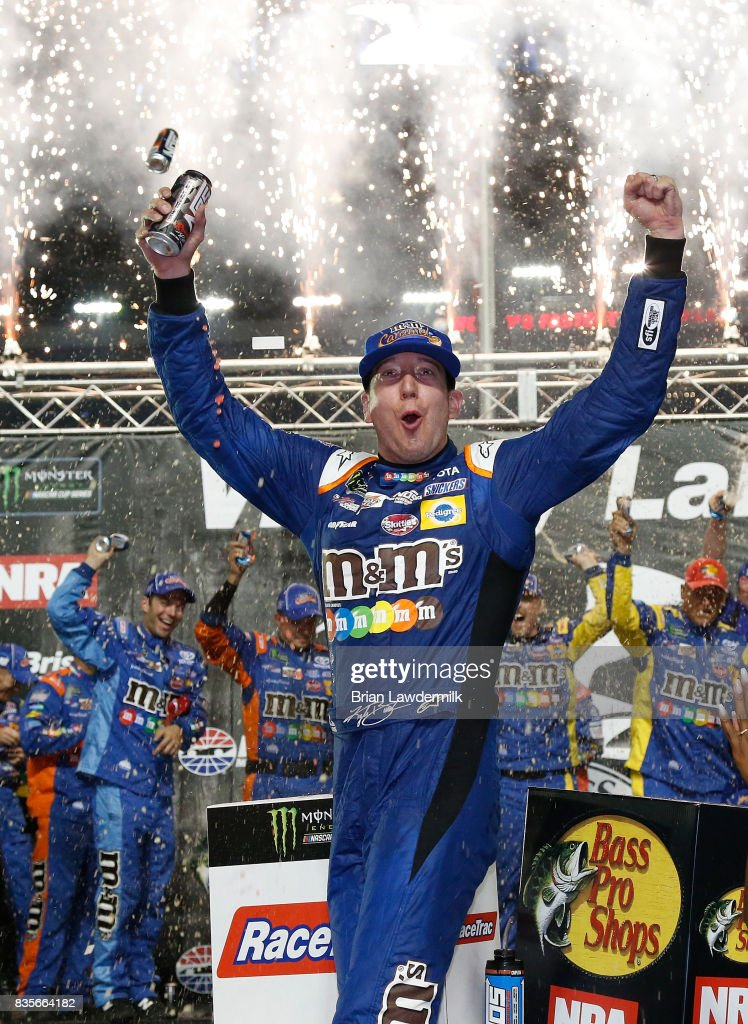 Kyle Busch, driver of the #18 M&M's Caramel Toyota, celebrates in victory lane after winning the Monster Energy NASCAR Cup Series Bass Pro Shops NRA Night Race at Bristol Motor Speedway on August 19, 2017 in Bristol, Tennessee.