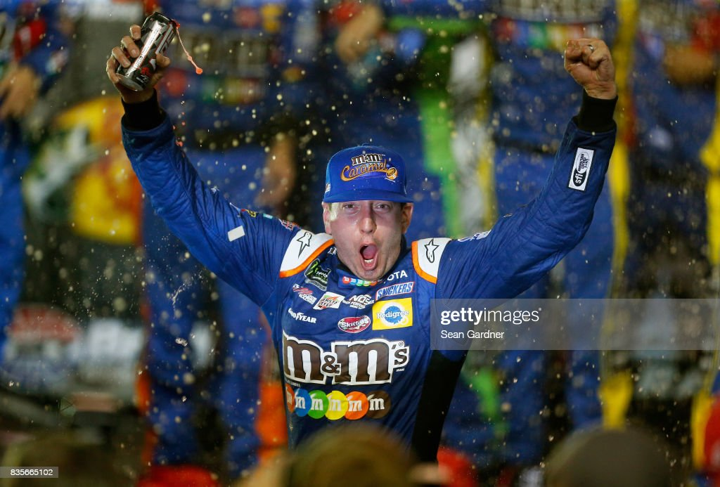 Kyle Busch, driver of the #18 M&M's Caramel Toyota, celebrates in Victoy Lane after winning the Monster Energy NASCAR Cup Series Bass Pro Shops NRA Night Race at Bristol Motor Speedway on August 19, 2017 in Bristol, Tennessee.