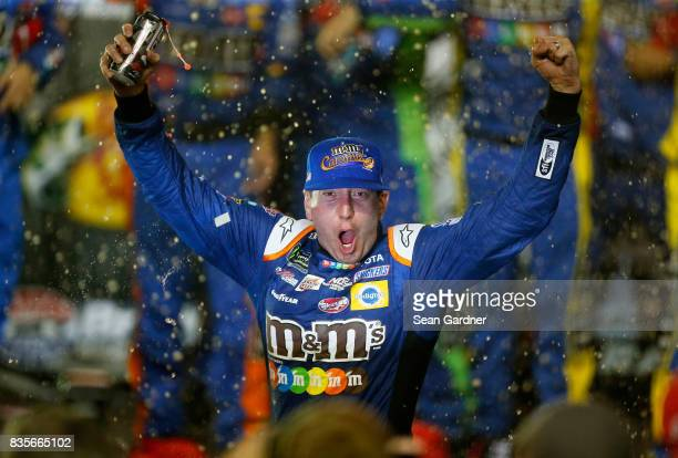 Kyle Busch driver of the MM's Caramel Toyota celebrates in Victoy Lane after winning the Monster Energy NASCAR Cup Series Bass Pro Shops NRA Night...