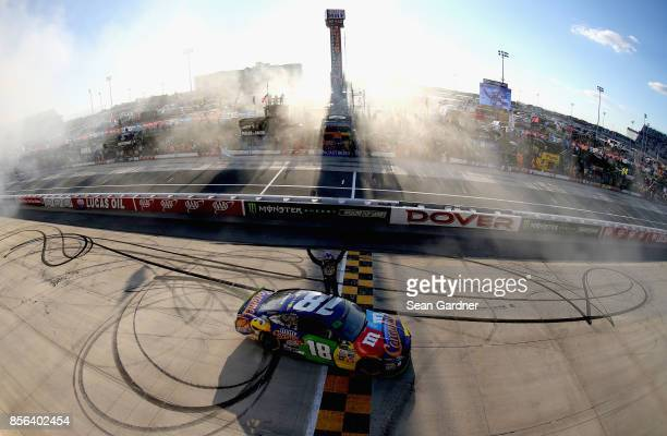 Kyle Busch driver of the MM's Caramel Toyota celebrates winning the Monster Energy NASCAR Cup Series Apache Warrior 400 presented by Lucas Oil at...