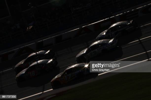 Kyle Busch driver of the MM's Caramel Toyota leads a pack of cars during the Monster Energy NASCAR Cup Series Alabama 500 at Talladega Superspeedway...