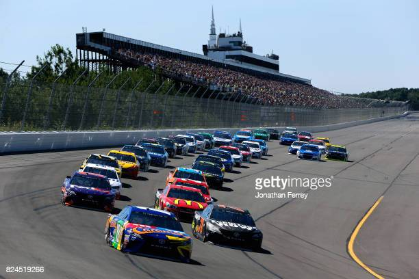 Kyle Busch driver of the MM's Caramel Toyota leads the field into turn one after taking the green flag to start the Monster Energy NASCAR Cup Series...