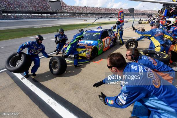 Kyle Busch driver of the MM's Caramel Toyota pits during the Monster Energy NASCAR Cup Series Alabama 500 at Talladega Superspeedway on October 15...