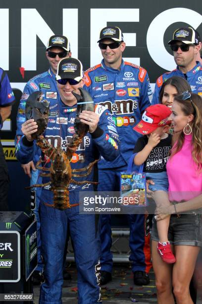 Kyle Busch driver of the MM's Carmel Toyota celebrates winning the Monster Energy NASCAR Cup Series ISM Connect 300 race on September 24 at New...