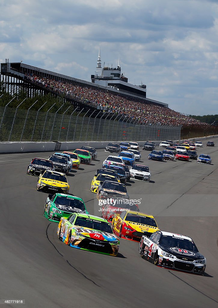 Kyle Busch driver of the MM's Crispy Toyota and Kevin Harvick driver of the Jimmy John's/Budweiser Chevrolet lead the field at the start of the...