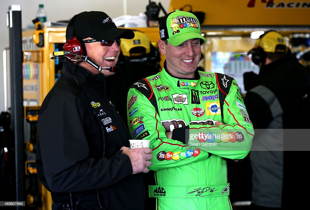 <a gi-track='captionPersonalityLinkClicked' href=/galleries/search?phrase=Kyle+Busch&family=editorial&specificpeople=211123 ng-click='$event.stopPropagation()'>Kyle Busch</a>, driver of the #18 M&M's Crispy Toyota, and team owner <a gi-track='captionPersonalityLinkClicked' href=/galleries/search?phrase=Joe+Gibbs&family=editorial&specificpeople=171526 ng-click='$event.stopPropagation()'>Joe Gibbs</a> during practice for the 57th Annual Daytona 500 at Daytona International Speedway on February 14, 2015 in Daytona Beach, Florida.