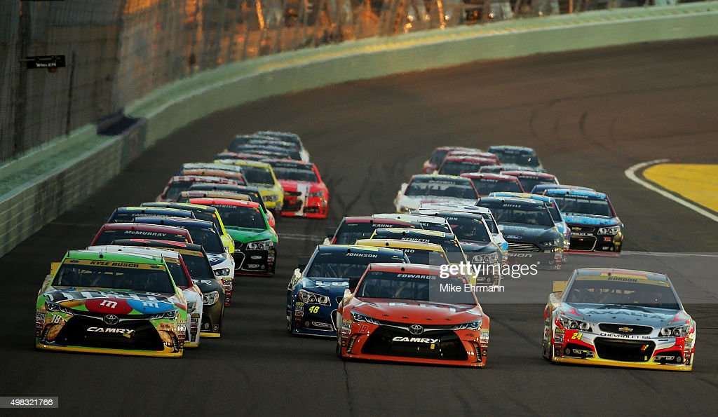 Kyle Busch driver of the MM's Crispy Toyota Carl Edwards driver of the ARRIS Toyota and Jeff Gordon driver of the AXALTA Chevrolet race three wide...