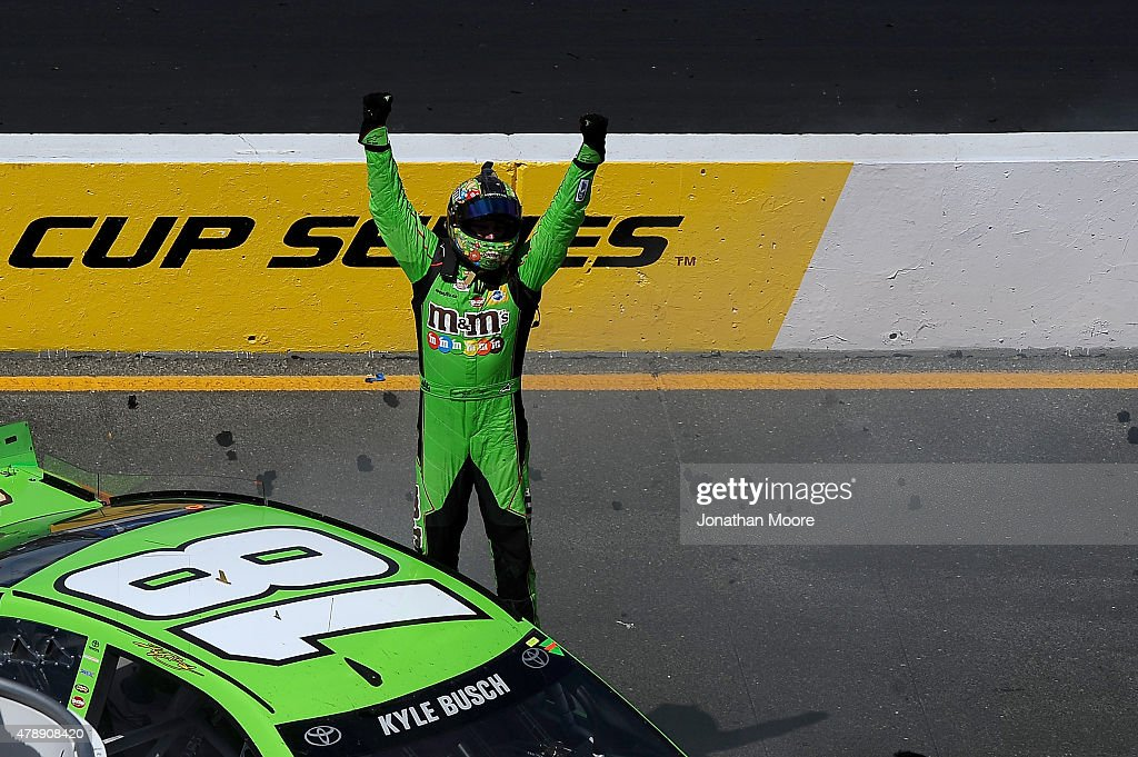 Kyle Busch driver of the MM's Crispy Toyota celebrates after winning the NASCAR Sprint Cup Series Toyota/Save Mart 350 at Sonoma Raceway on June 28...