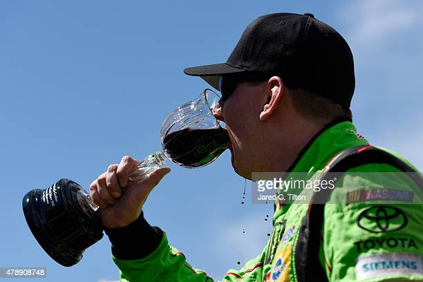 Kyle Busch driver of the MM's Crispy Toyota celebrates by drinking wine after winning the NASCAR Sprint Cup Series Toyota/Save Mart 350 at Sonoma...