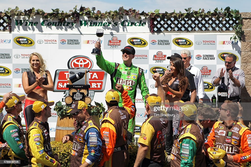 Kyle Busch driver of the MM's Crispy Toyota celebrates in Victory Lane after winning during the NASCAR Sprint Cup Series Toyota/Save Mart 350 at...
