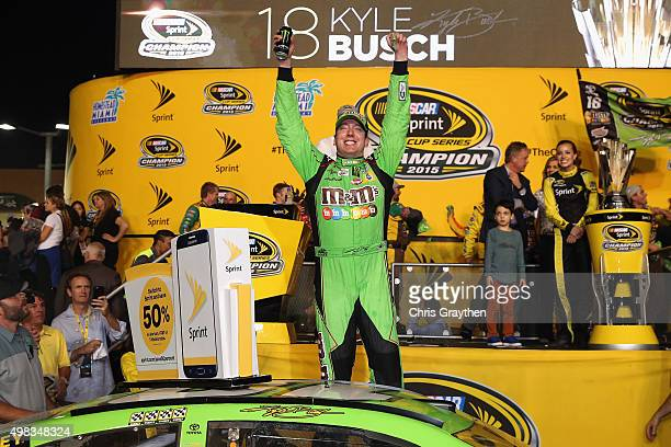 Kyle Busch driver of the MM's Crispy Toyota celebrates winning the series championship and the race in Victory Lane after the NASCAR Sprint Cup...